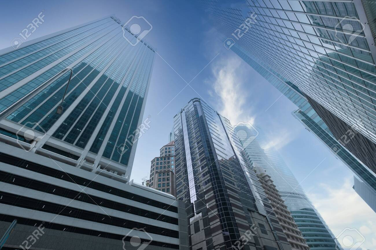 low angle view of Singapore financial buildings in blue sky - 140012168