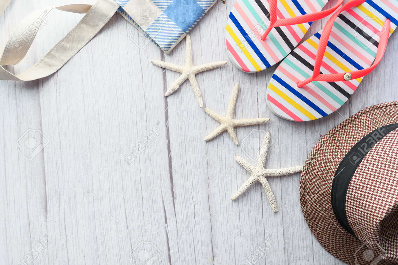flat composition of summer beach accessories on table. - 156686426