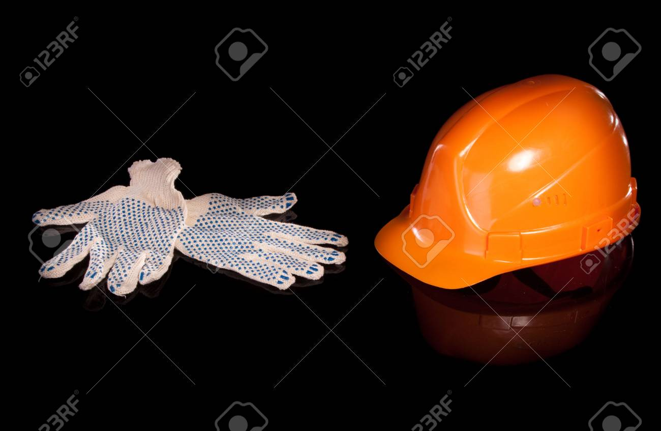 Hard hat and work gloves isolated on white background Stock Photo - 6833177