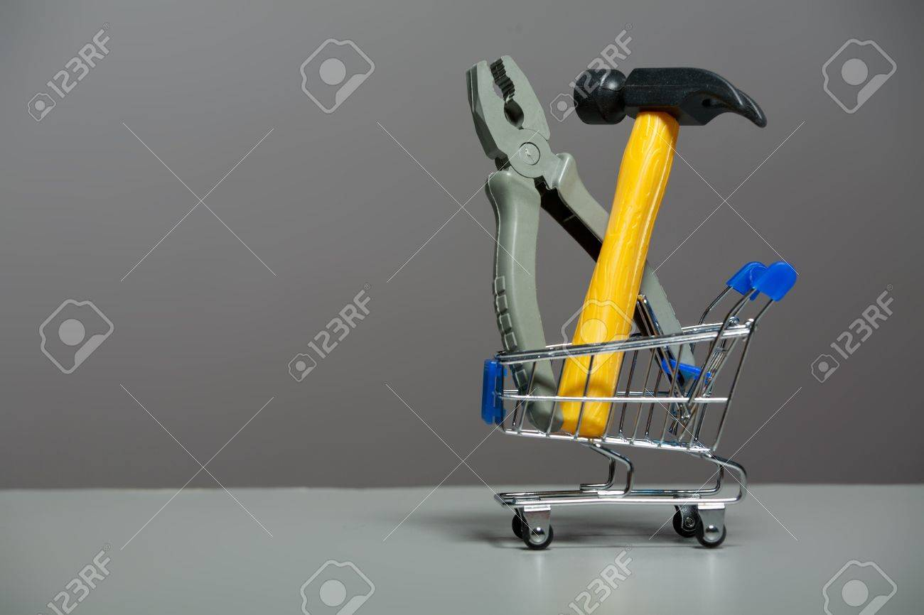 Shopping carts with a hammer and pliers Stock Photo - 10300144
