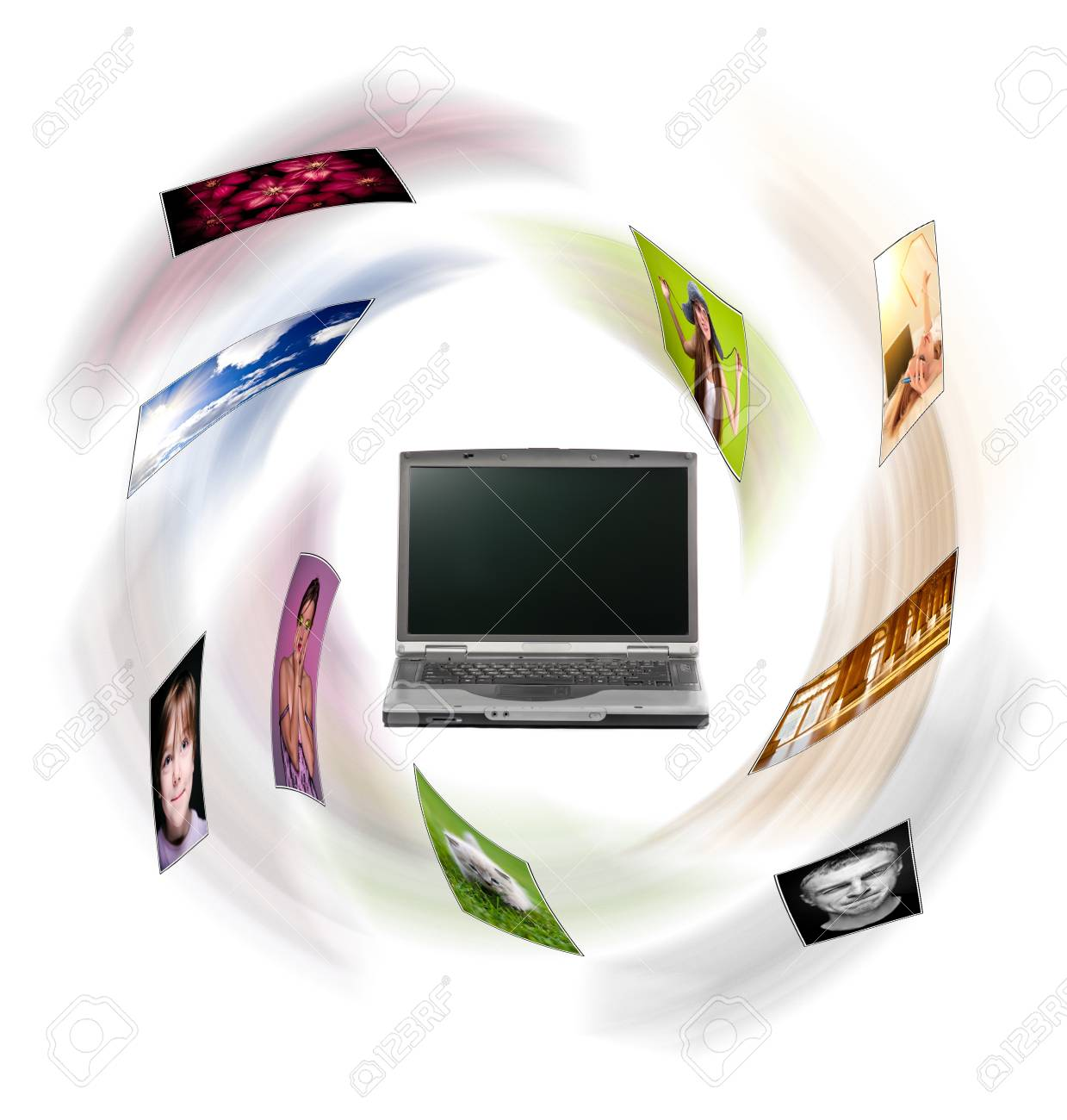 A laptop and digital pictures flying. Stock Photo - 10366742
