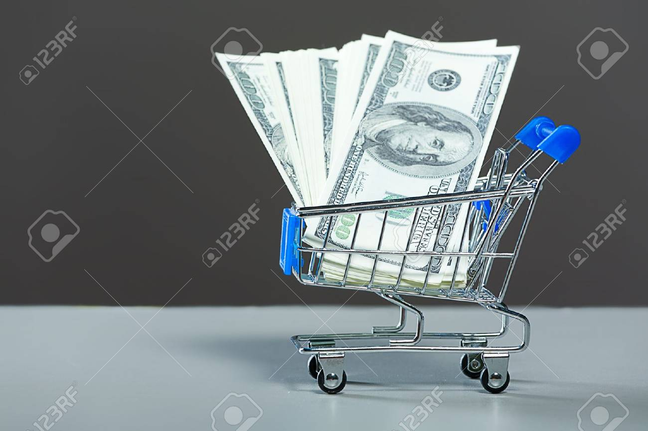 Shopping carts with a dollars. Stock Photo - 10386234