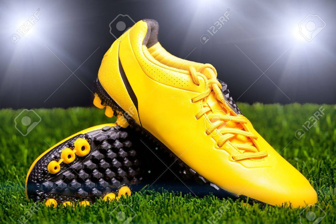 Football boots on the grass Stock Photo - 10763396