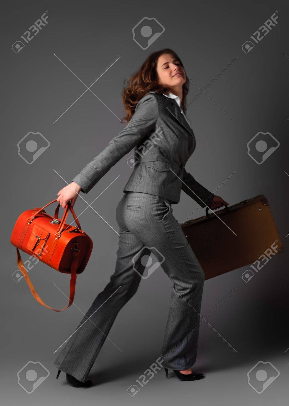 A businesswoman with a bag and a suitcase. Stock Photo - 11230751