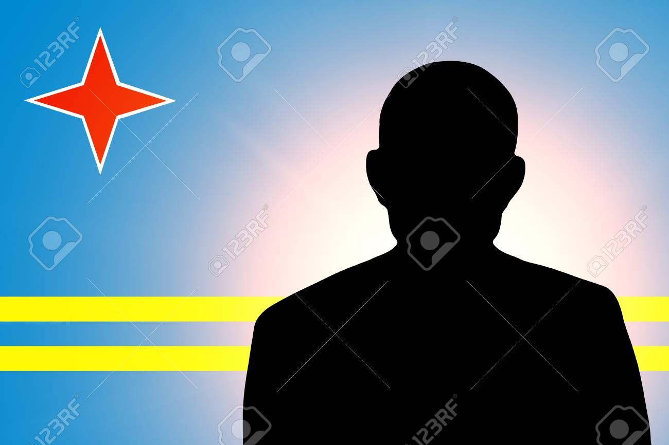 The Aruba Flag and the silhouette of an unknown man Stock Photo - 15943513