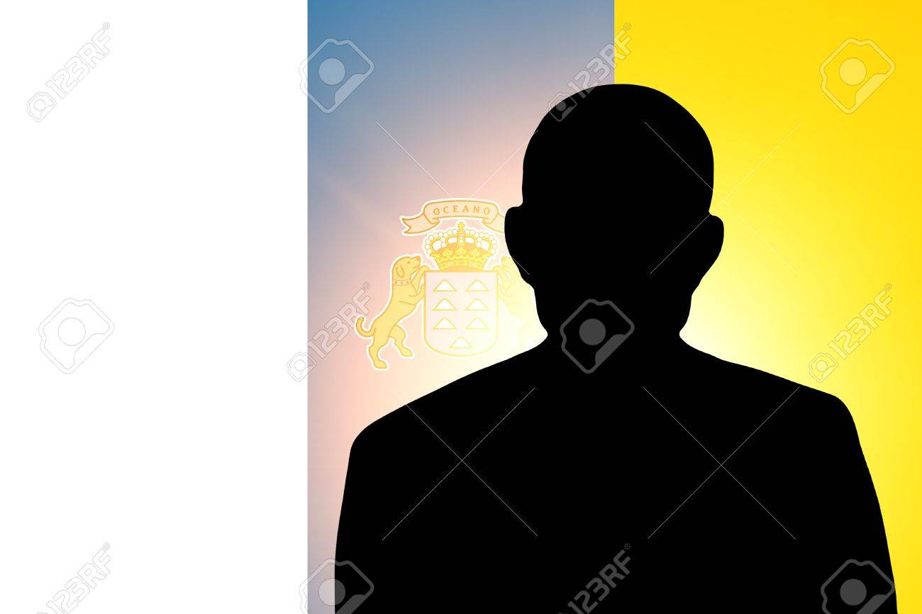 The Canary Islands flag and the silhouette of an unknown man and the silhouette of an unknown man Stock Photo - 15943352
