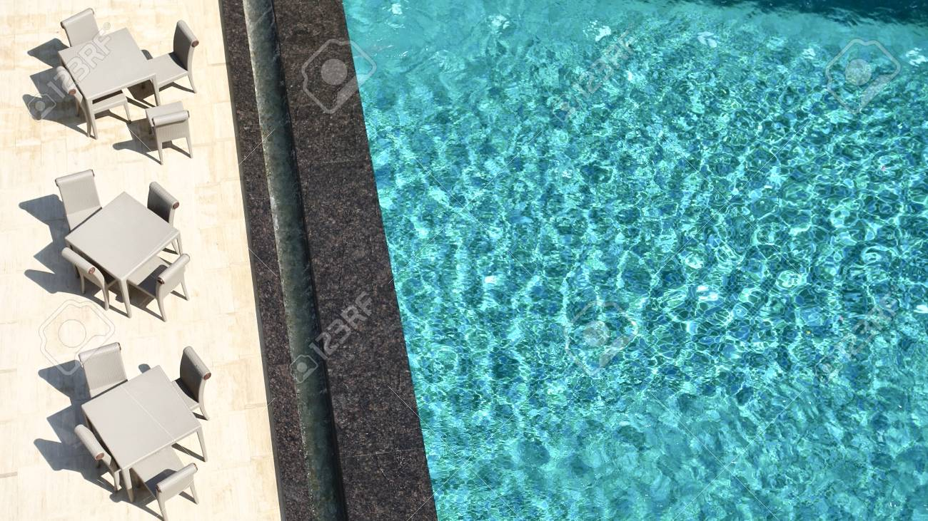 Water ripples on blue tiled swimming pool background, View from..