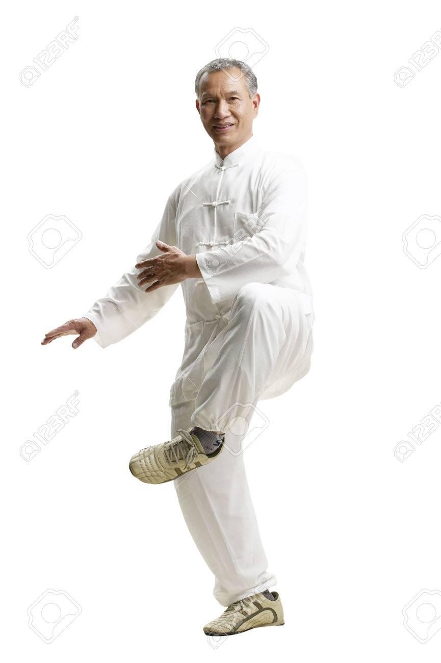 Portrait of senior man wearing Tai Chi clothes - 80610311