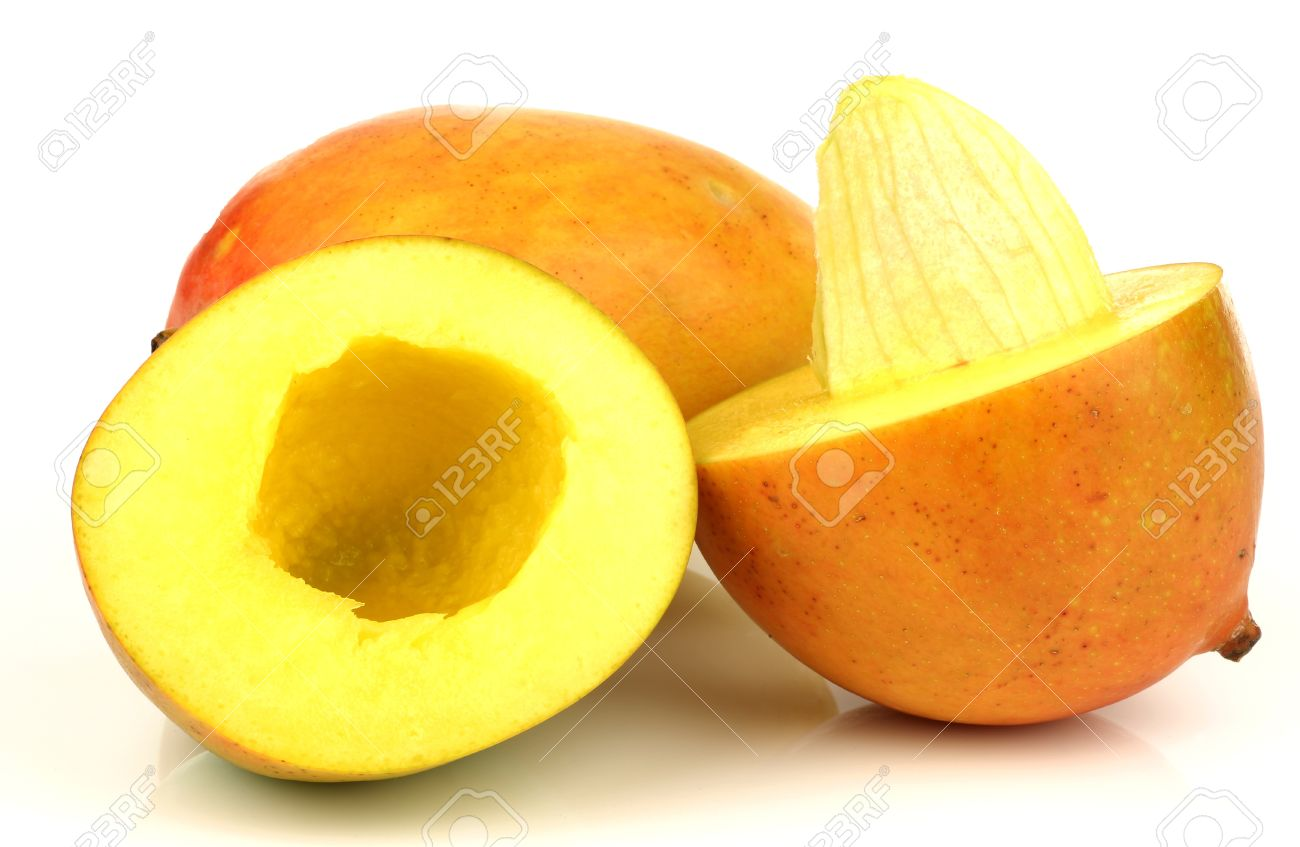 Stock Photo Two Fresh Mango Fruits With One Cut And Seed Visible On A White  Background