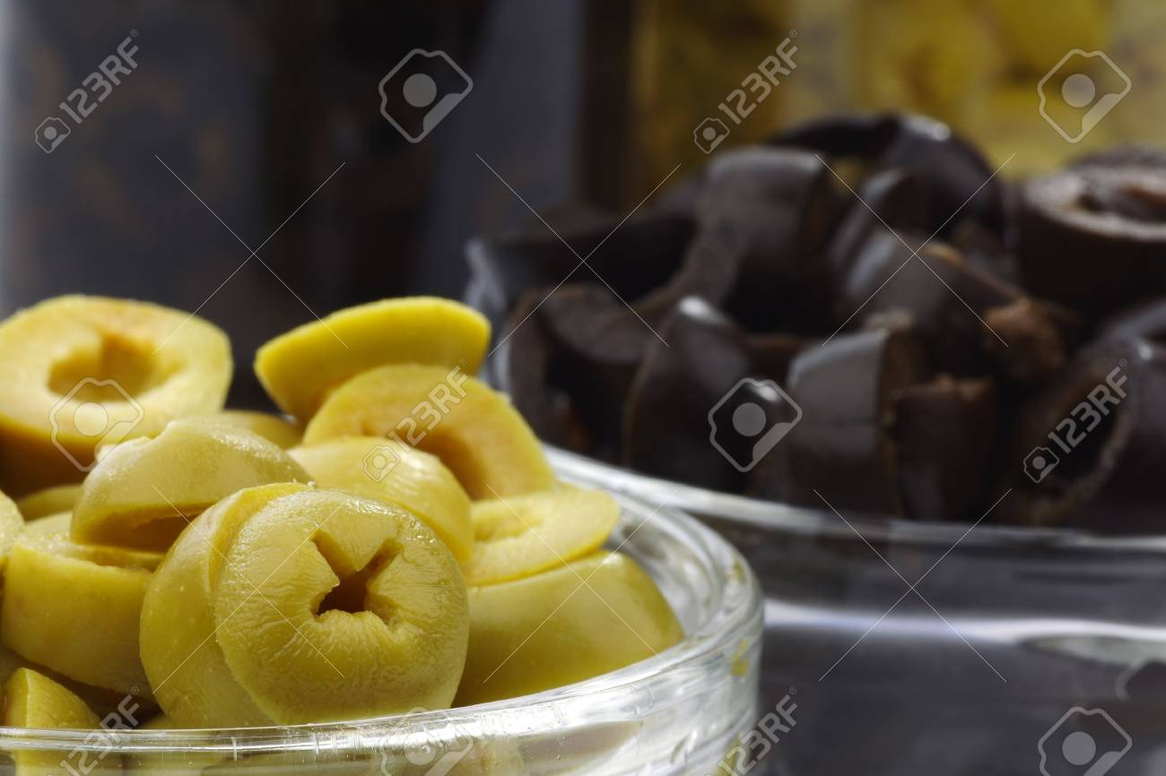 freshly cut green and black olive rings in glass bowls Stock Photo - 15081394
