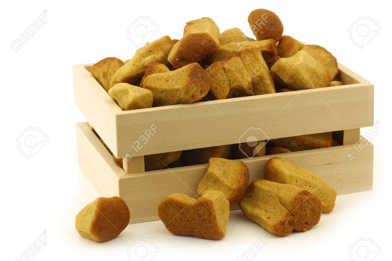 bunch of Dutch traditionally baked  pepernoten  eaten at Dutch festivities around december 5th called  Sinterklaas  in a wooden box on a white background Stock Photo - 16172887