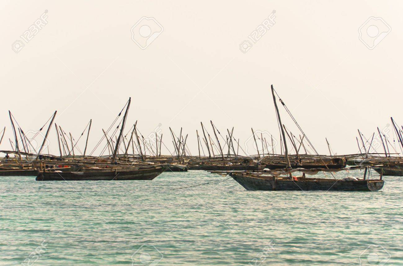 Old working fishing boats against dull grey sky Stock Photo - 16493943
