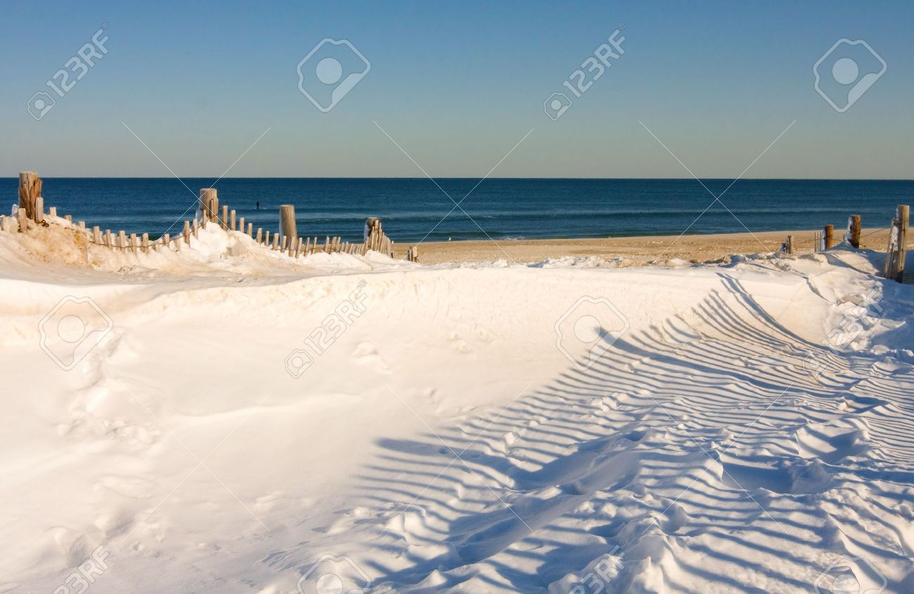 Snow covers part of the beach at the Jersey Shore. Stock Photo - 5255718