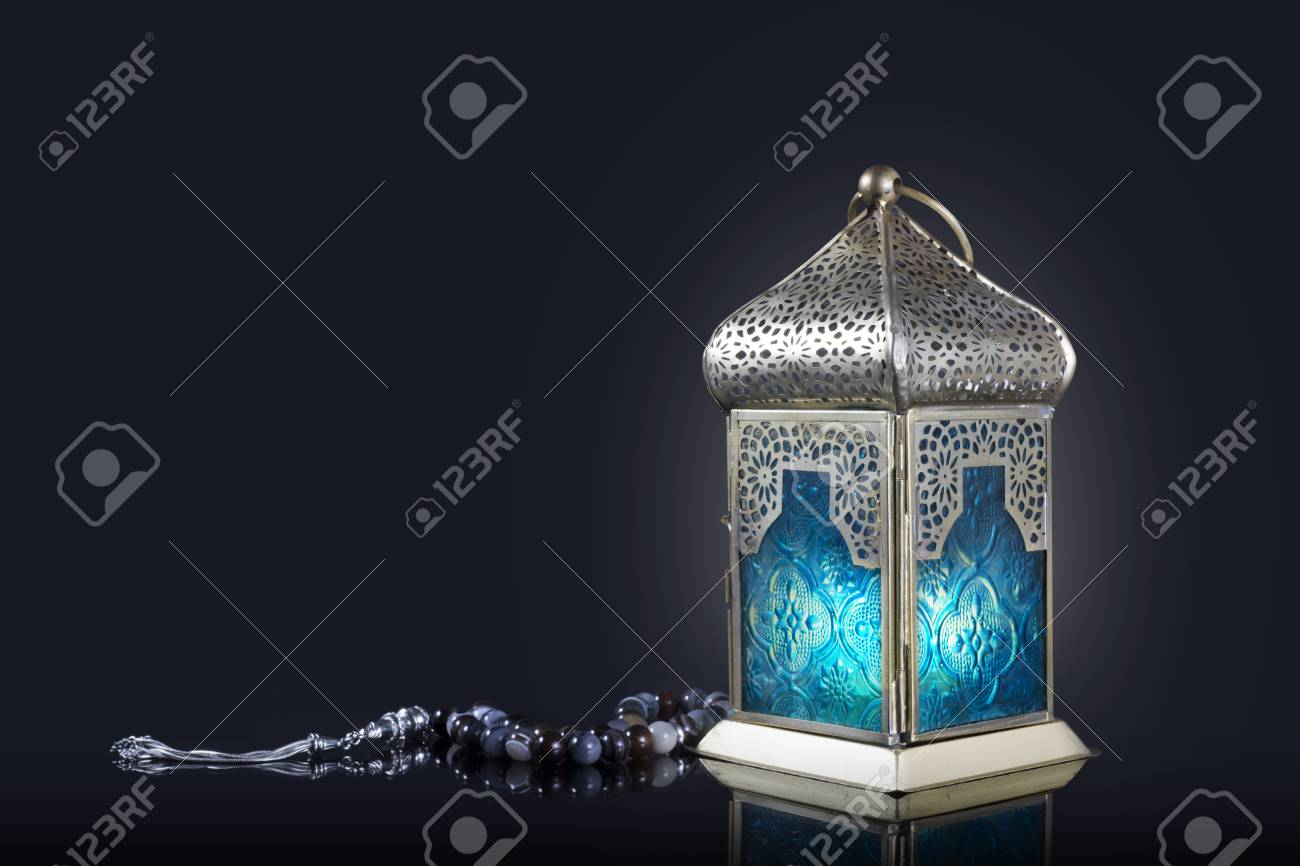 Traditional lantern with rosary beads on a dark background - 87657500