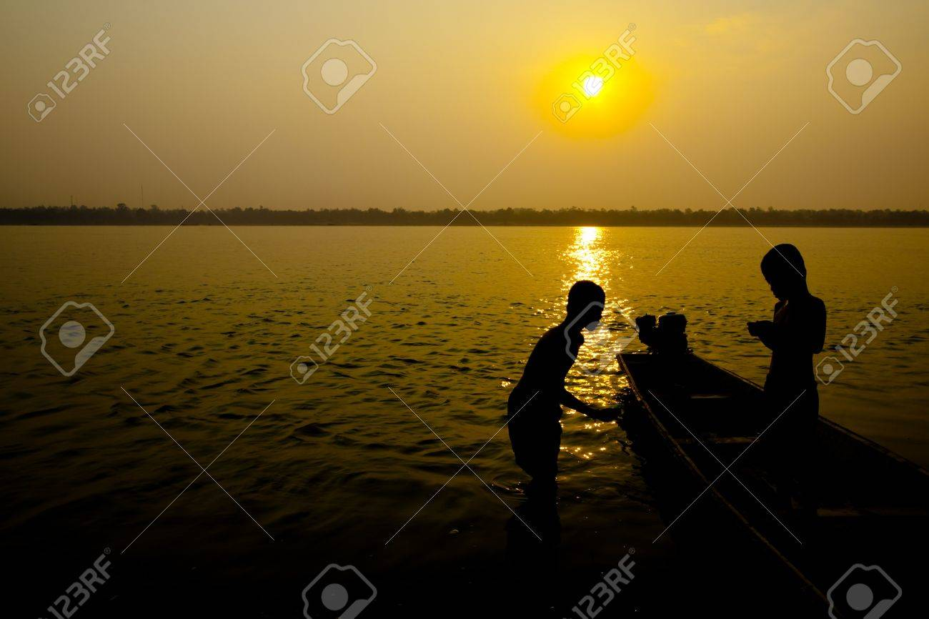 Children are playing at riverside on early morning Stock Photo - 10311489