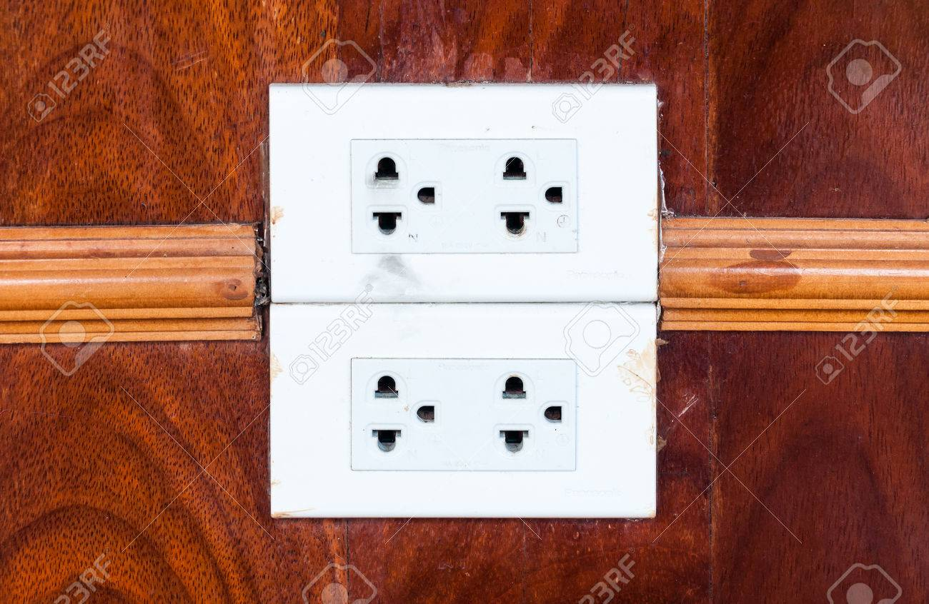 Dirty White Outlet On The Wooden Wall Of Living Room. Stock Photo ...