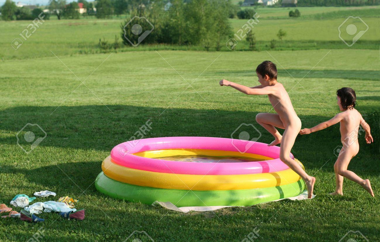 Nudist children Stock Photo - crazy children, summerfun sibling in pool, jumping to water