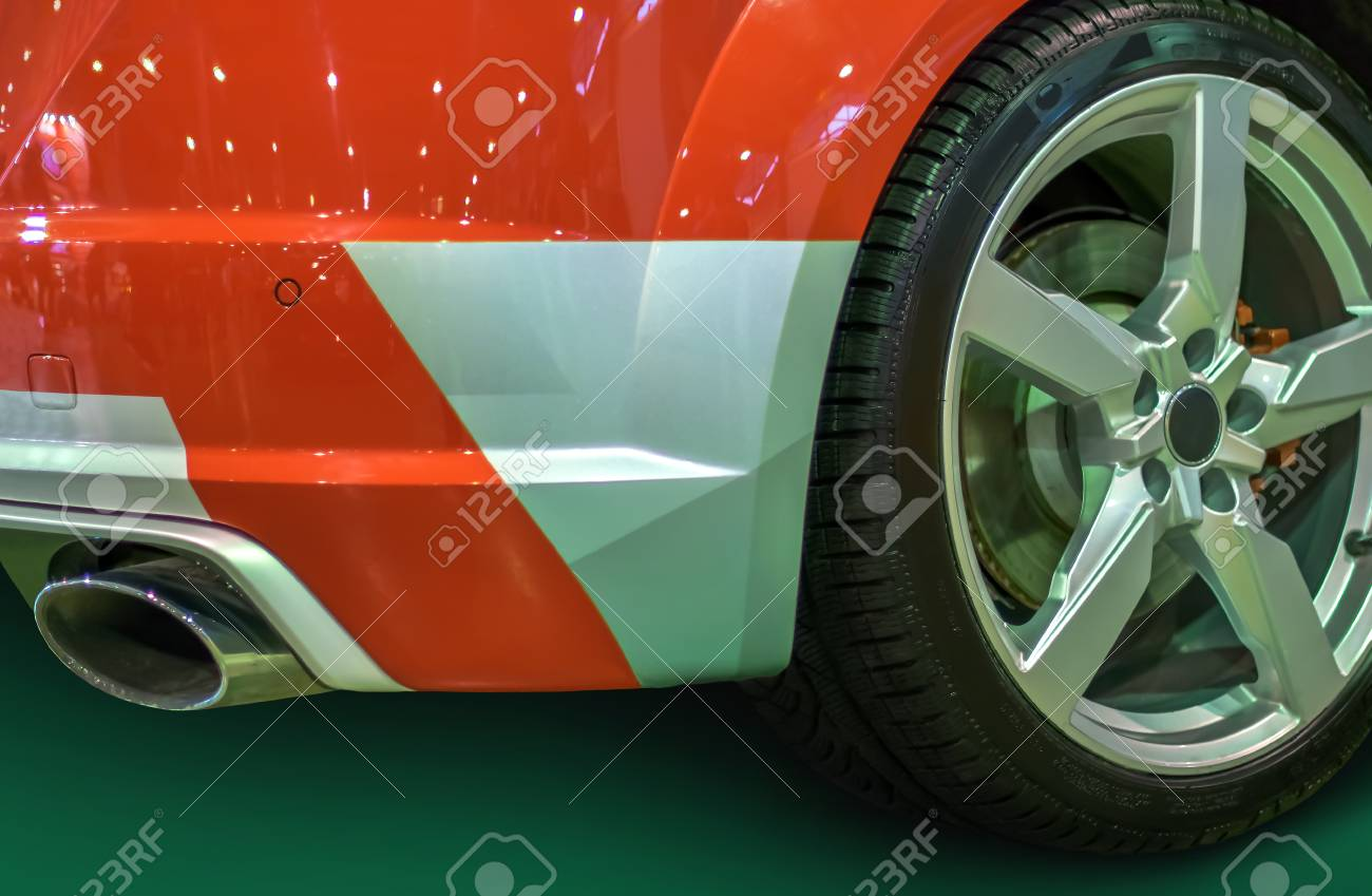 Wheel With Titanium Disc And A Racing Tire And The Rear Bumper - Car show wheel stands