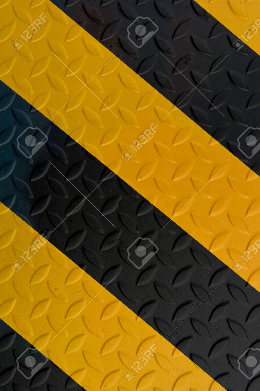 Yellow and black warning sign on Metal Plate Stock Photo - 11298159