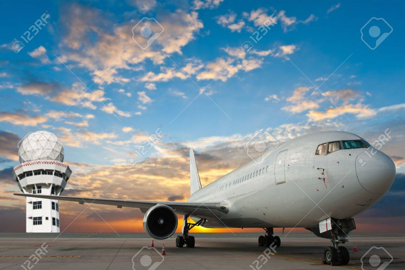 Commercial airplane at the airport with control tower Stock Photo - 13843338