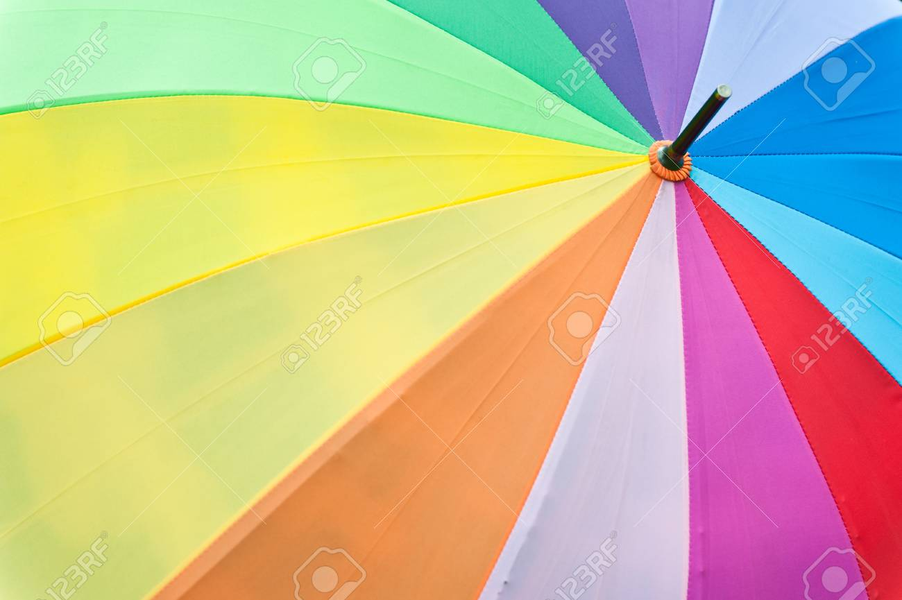Colorful umbrella on grass Stock Photo - 13843501