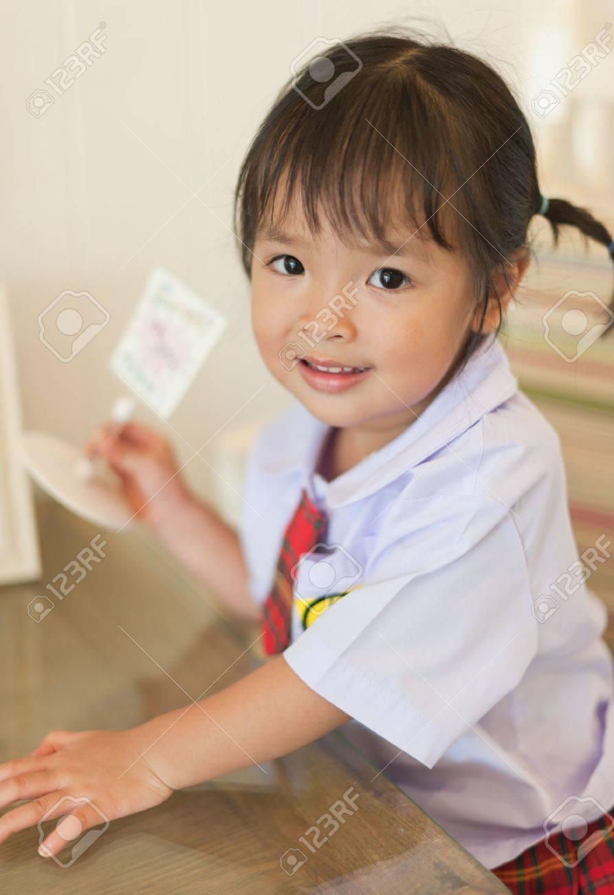 Little Asian Schoolgirl Stock Photo 14109560