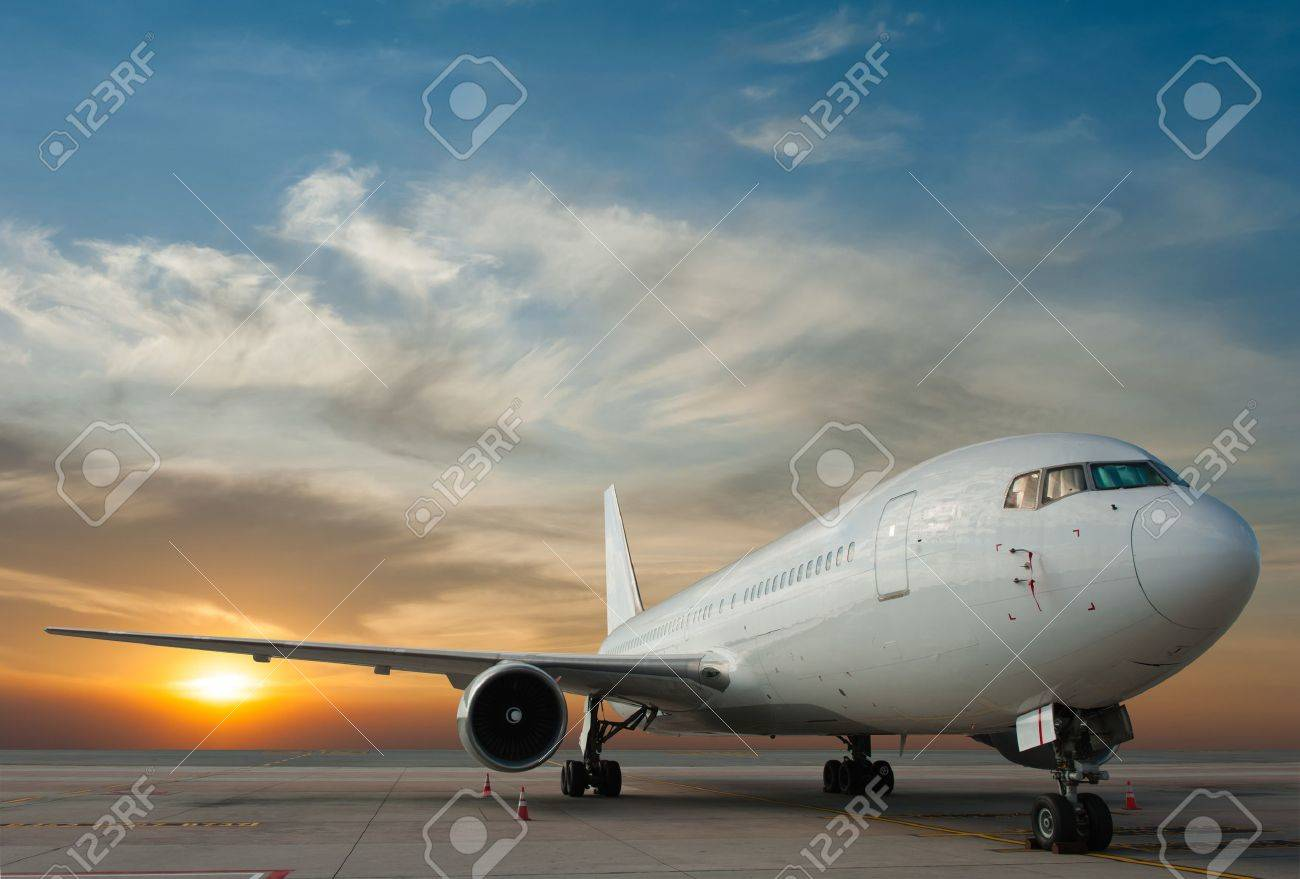 Commercial airplane with sunset Stock Photo - 21231186