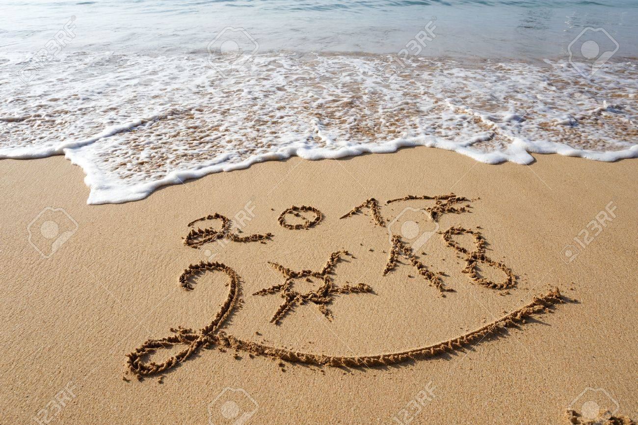 happy new year 2018 lettering on the beach stock photo 84008535