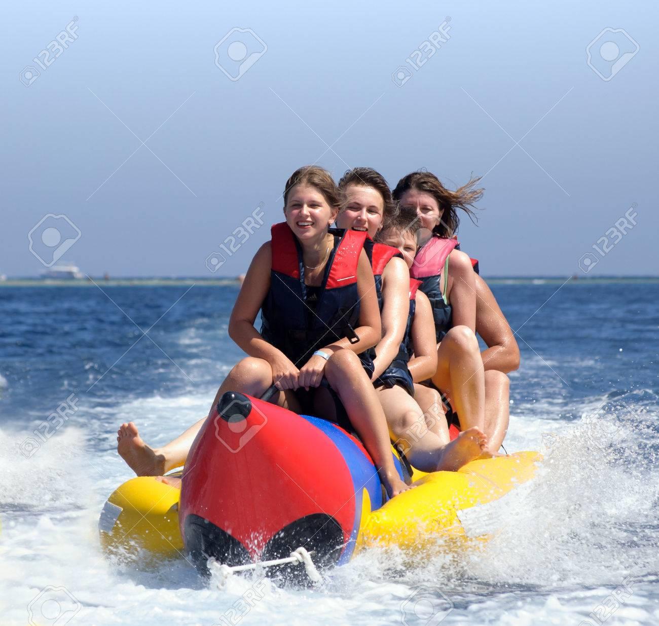 happy people having fun on banana boat on the red sea - 66701524