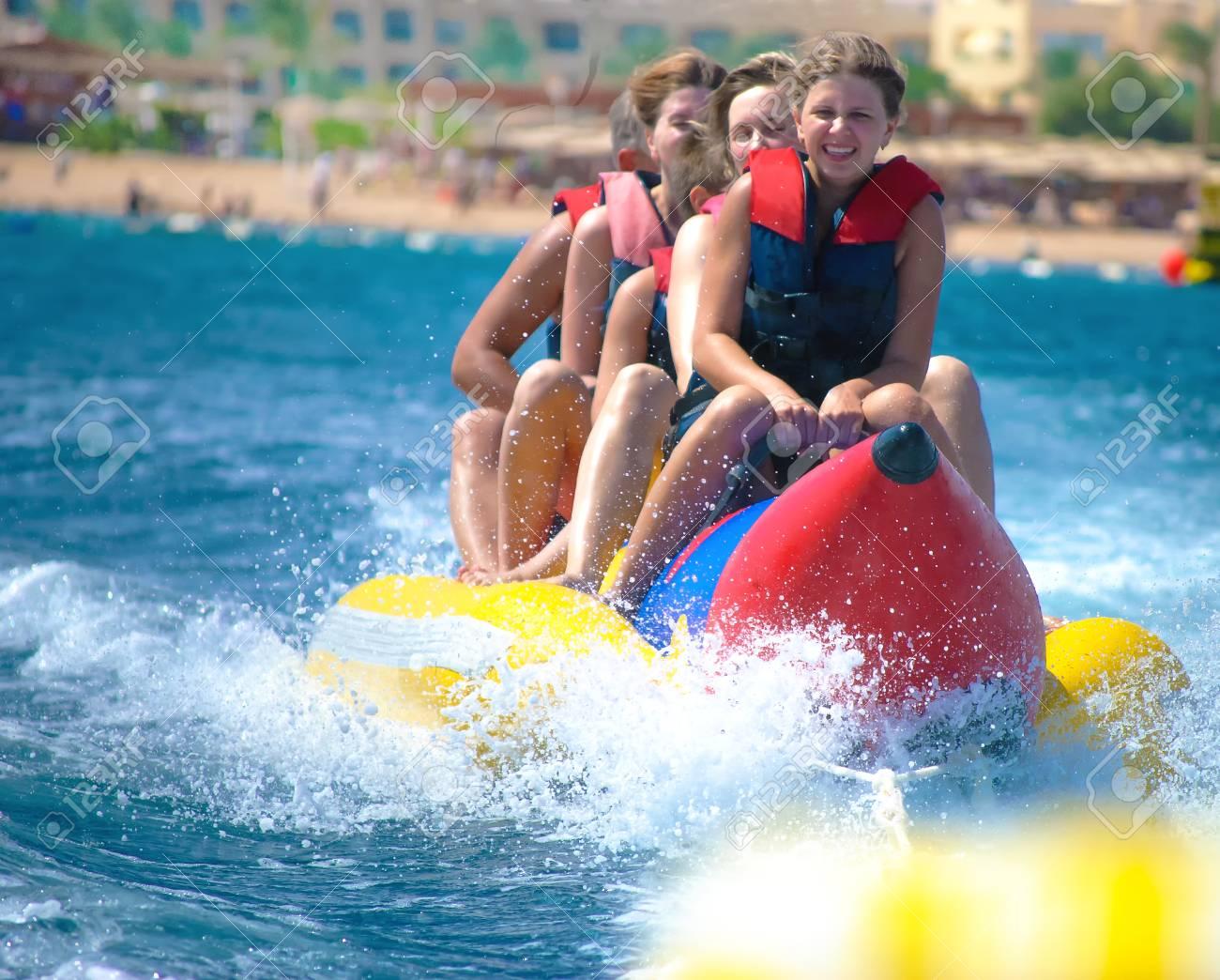 People ride on banana boat - 73580687