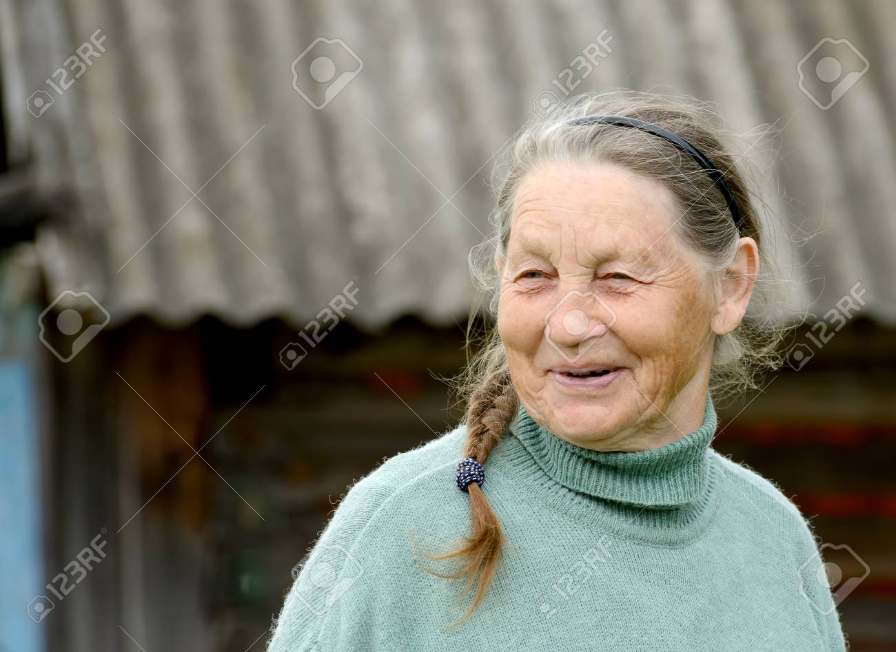 Portrait of smiling elderly woman outdoors - 81037949