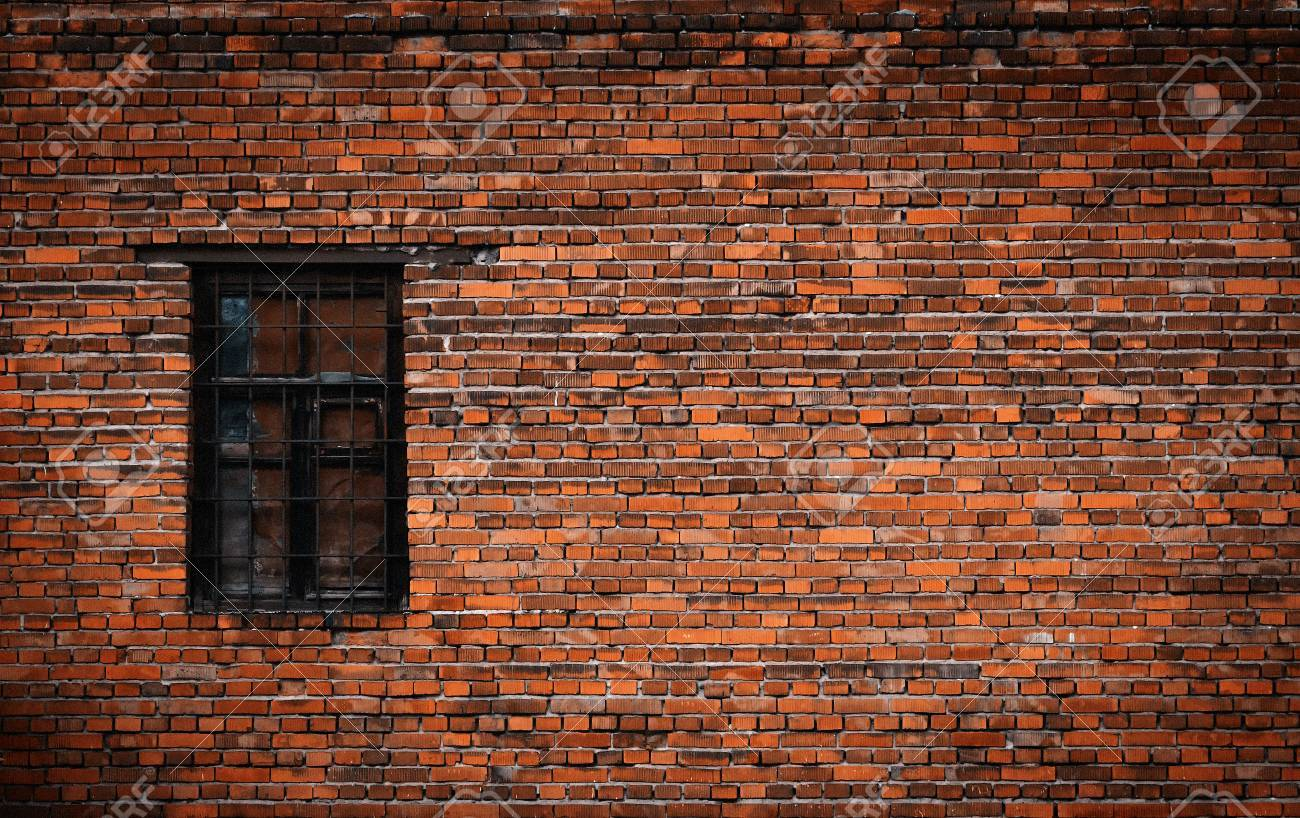 Old black brick wall and window locked with metal bars - 83086622
