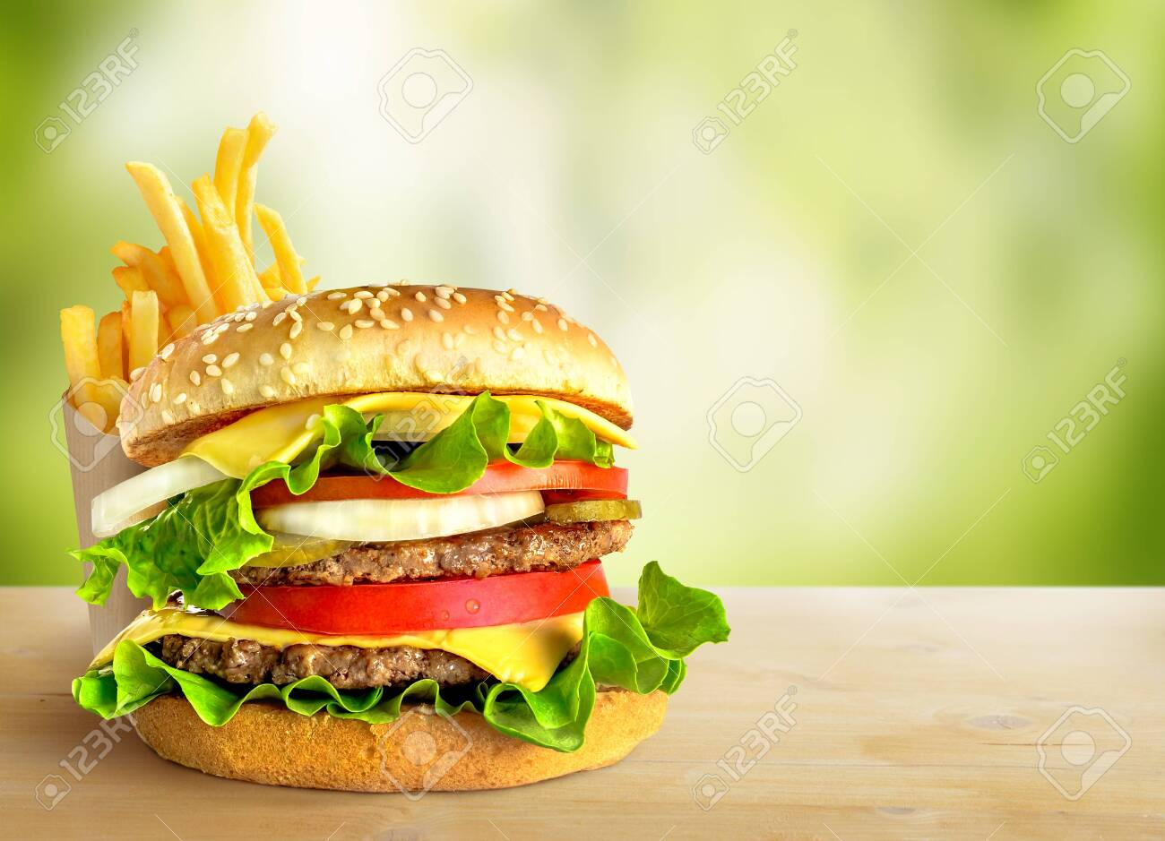 Fresh double hamburger and french fries on green nature background. Copy space - 153909145
