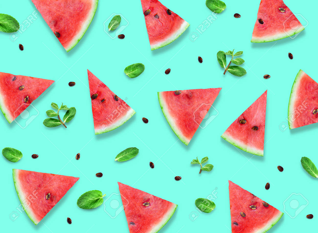Watermelon slices with fresh mint leaves pattern. - 169711071