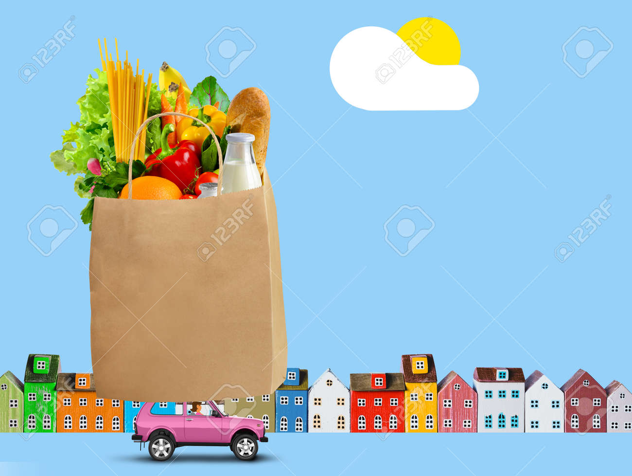 Pink car with shopping paper bag with groceries on the roof on city background - 169711074