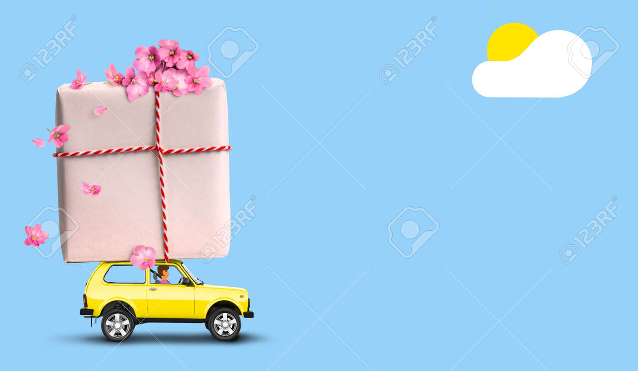 Yellow car with gift box on a roof with flowers on blue background. - 169711080