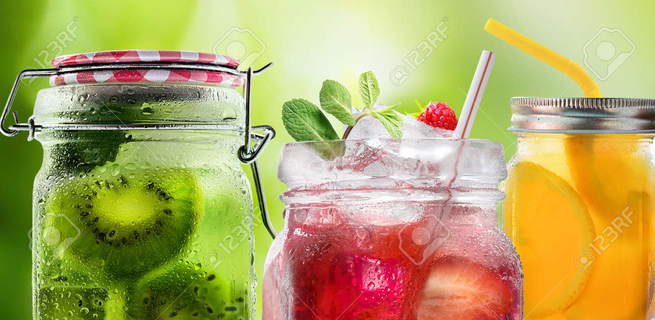 Bright Colorful refreshing summer drinks in glass jars with ice on a white background - 170274593