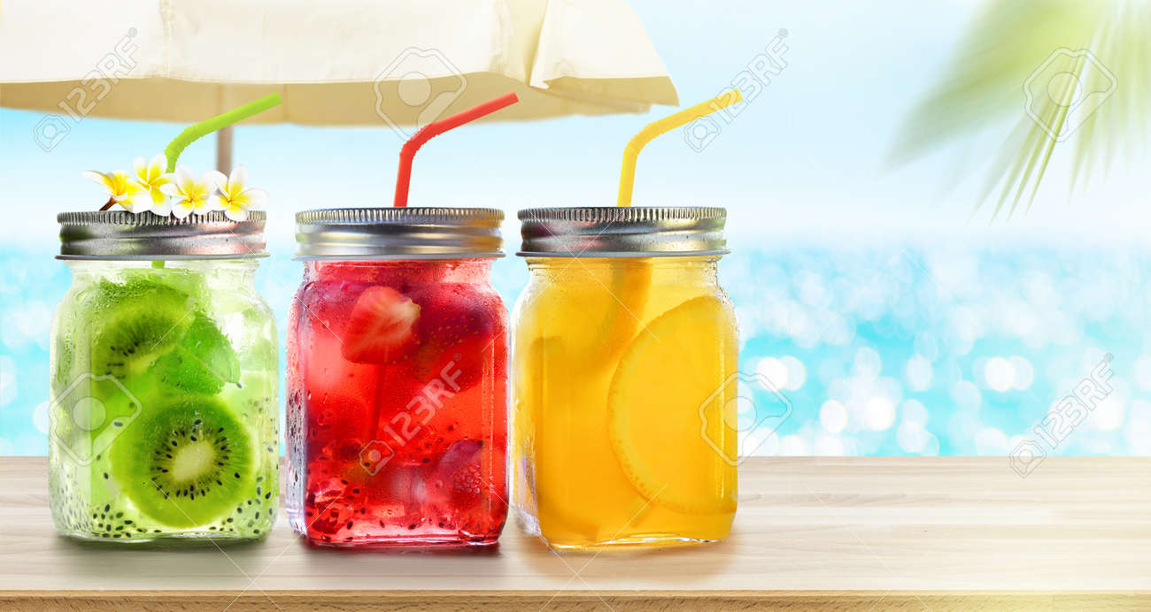 Summer refreshing exotic drinks cocktails in glass jars with straws on seascape with bokeh sun light background. - 170287909
