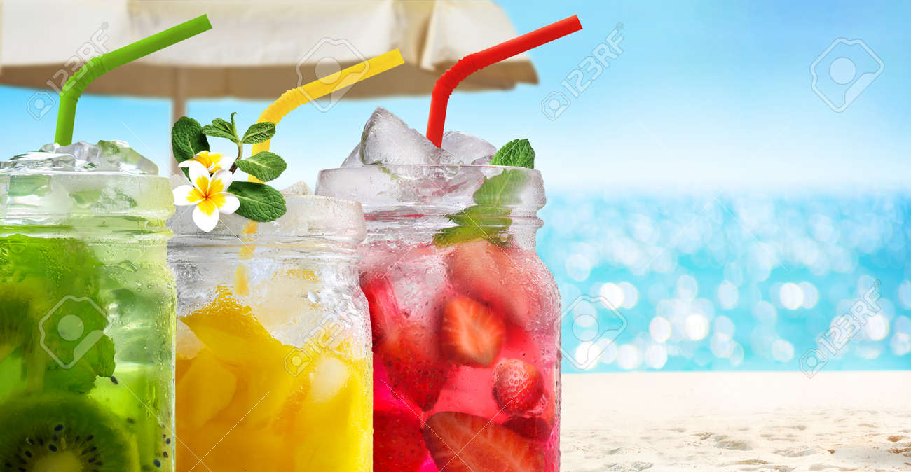 Summer refreshing exotic drinks cocktails in glass jars with straws on seascape with bokeh sun light background. - 170695715