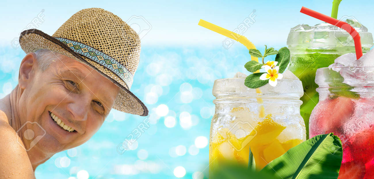 A man is enjoying his vacation relaxing with refreshing drinks on the sea beach on blue turquoise sea background. - 170867386