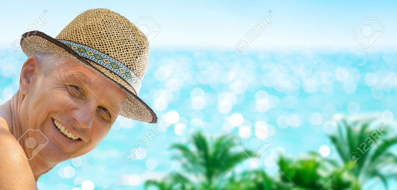 Man have fun, smiling to the camera, relaxing by the sea beach on blue turquoise sea background. - 170867501