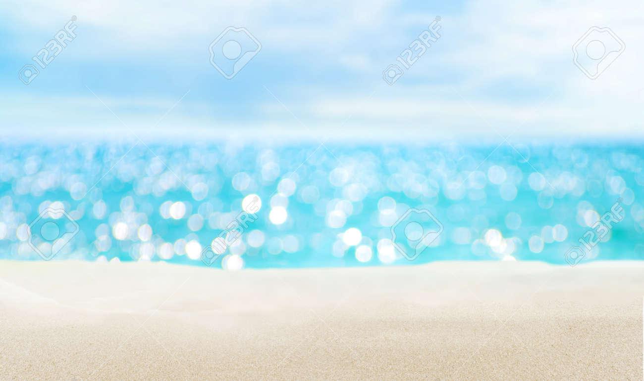 Seascape and sandy beach. Defocused sea water surface glittering on the sun. - 171223465