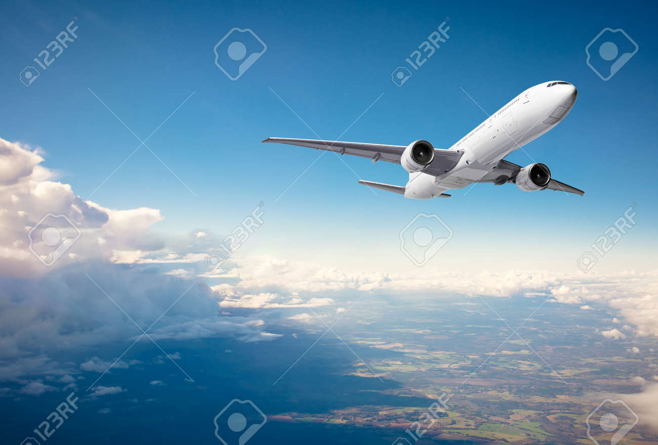 Commercial airplane flying above clouds on blue sky background - 171548534
