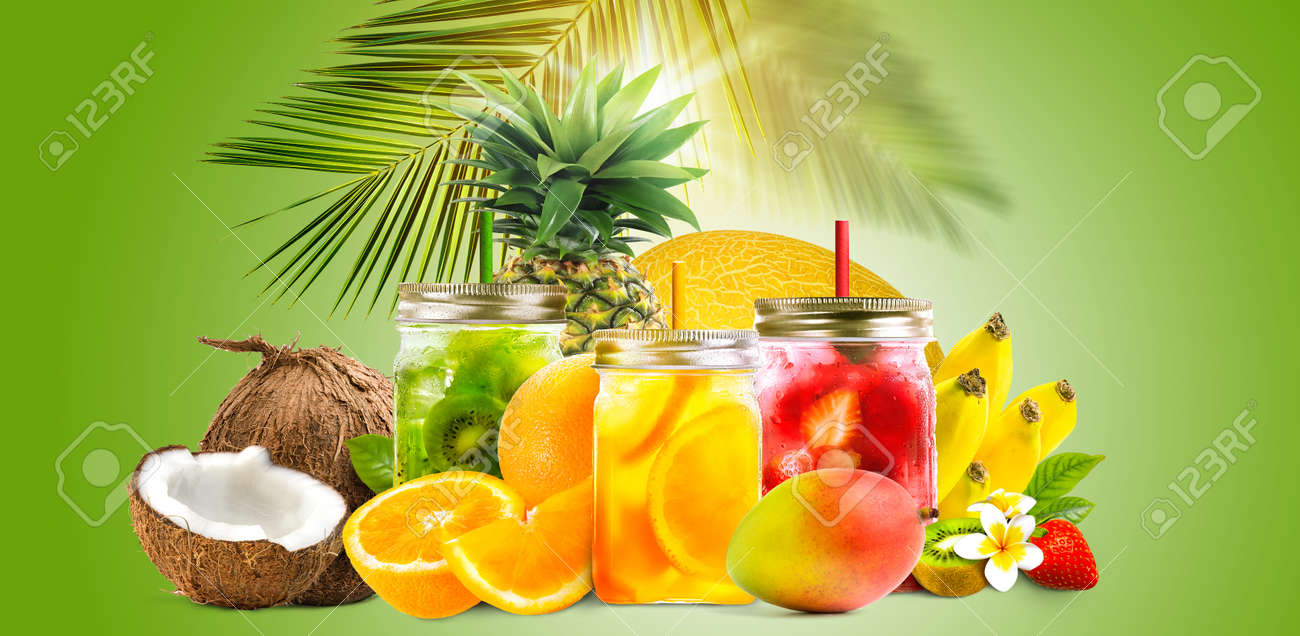 Fresh jars of juice with fruit mix on green background. Concept of tropical summer cocktails, drinks, lemonade - 171427617