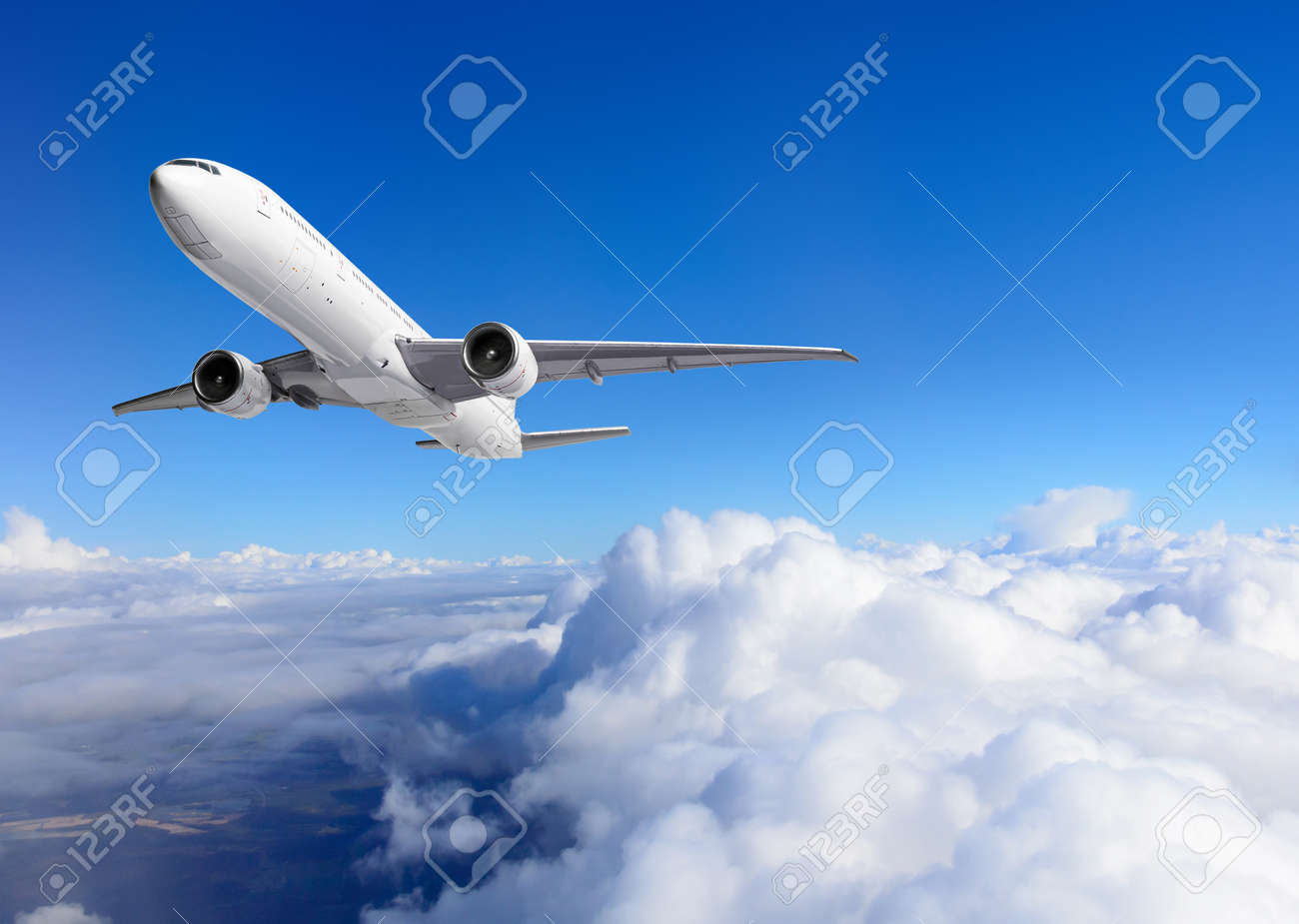 Airplane flying above clouds on blue sky background - 171548536