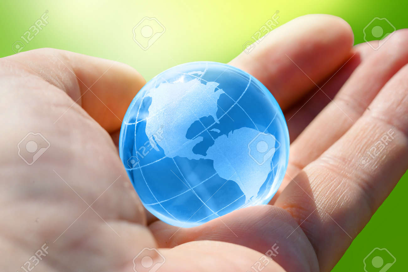 Blue Glass globe of the planet Earth in human hand - 171638954