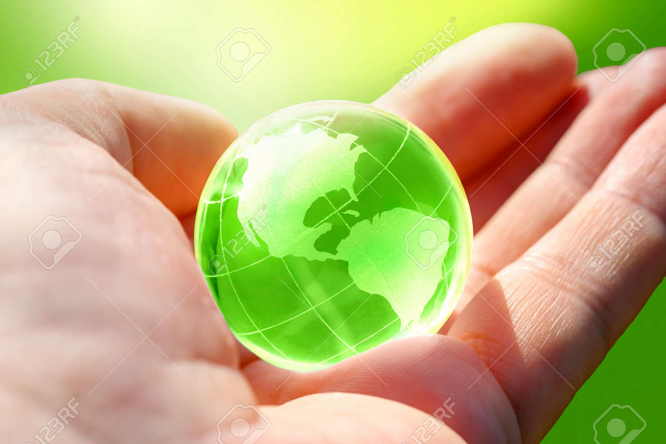 Green Glass globe of the planet Earth in human hand - 171699202