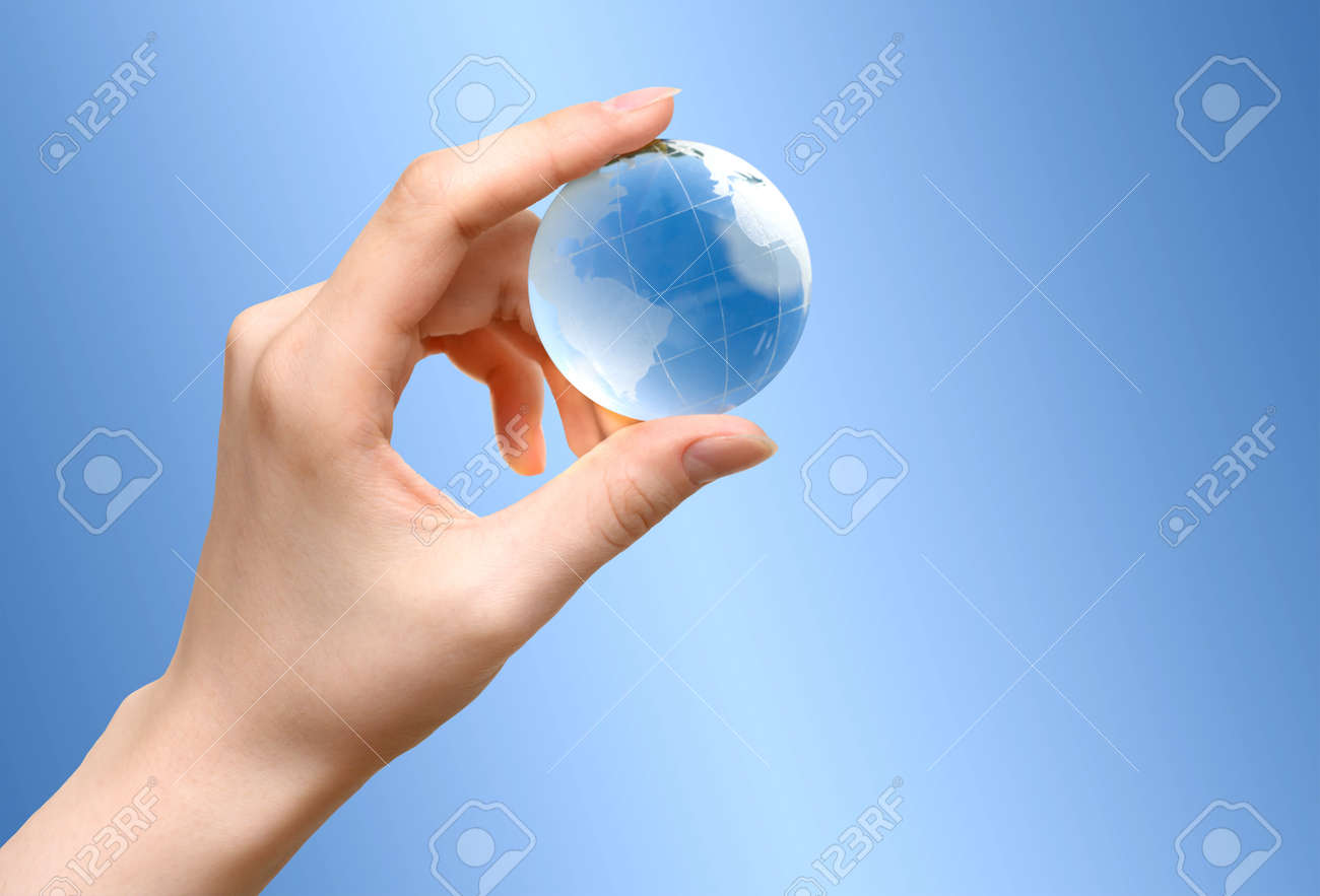 Blue Glass globe of the planet Earth in female hand - 171737565