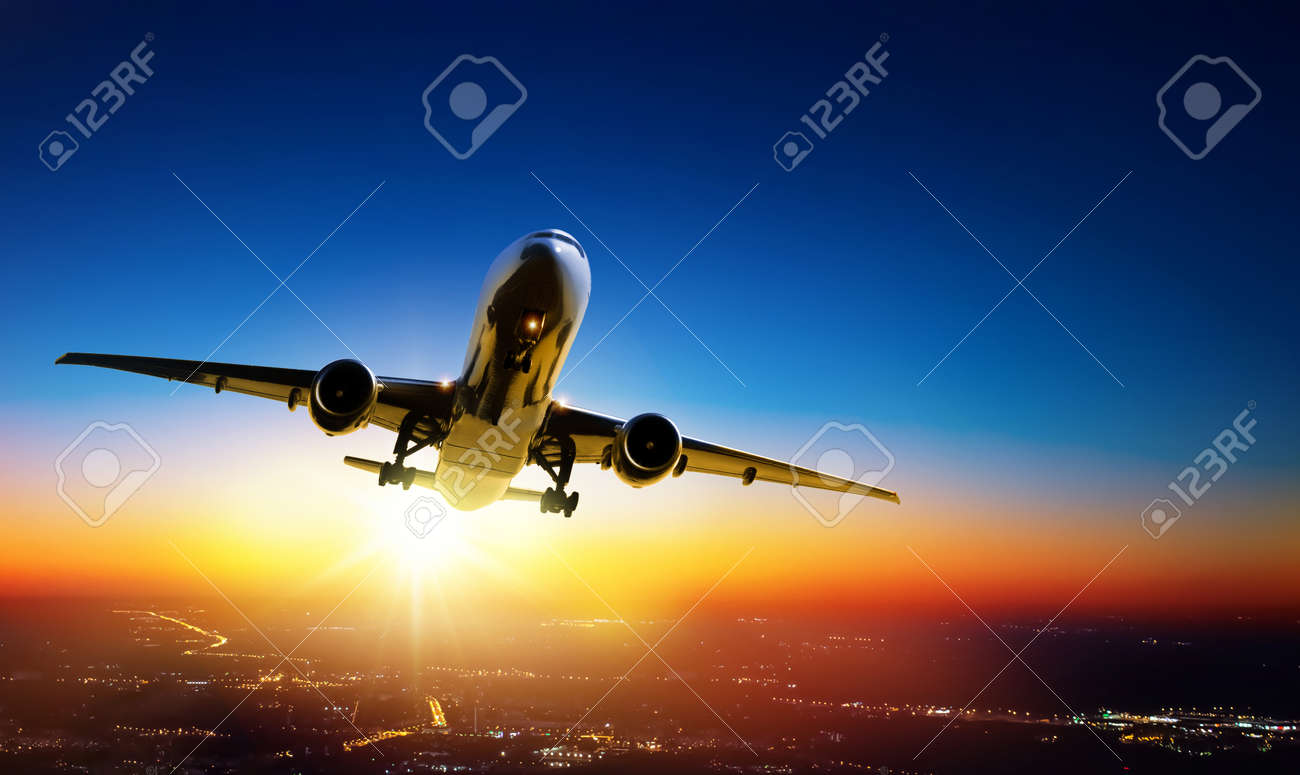 Plane goes on takeoff at sunset over the city lights - 171776813