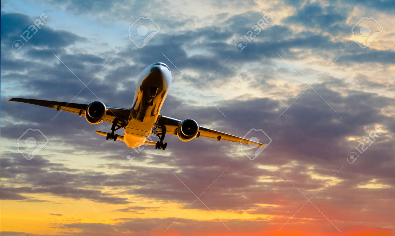 Plane goes on takeoff at sunset on cloudy sky background - 171997689